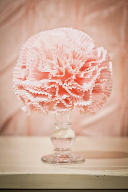 http://www.karaspartyideas.com/2011/01/cupcake-liner-pom-poms-tutorial-vintage.html